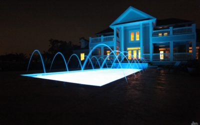 fiberglass pool at night with led lighting and laminar jets