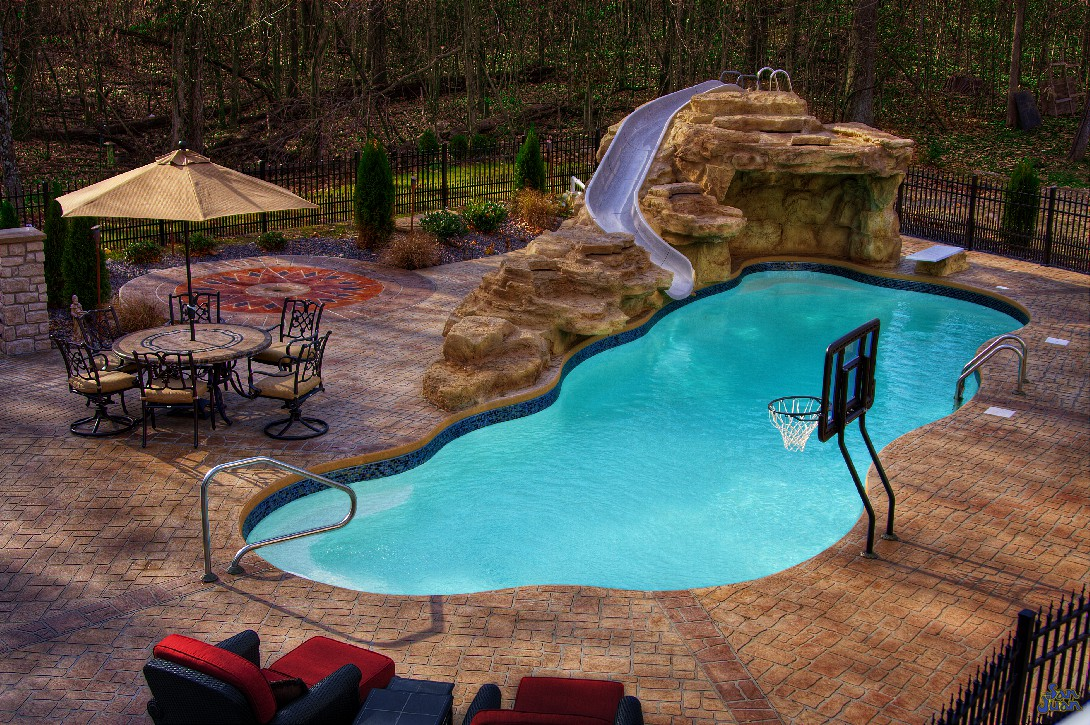 inground fiberglass pools with basketball goal, slide and water features