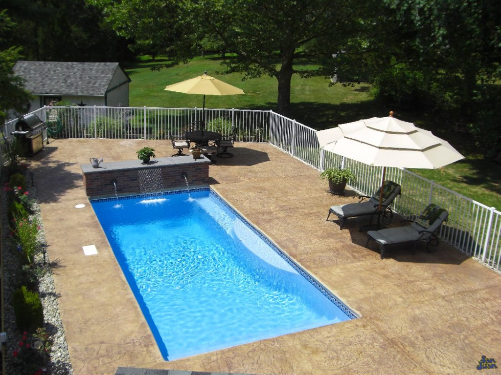 Wylela Fiberglass Pool with stamped and stained concrete and water features