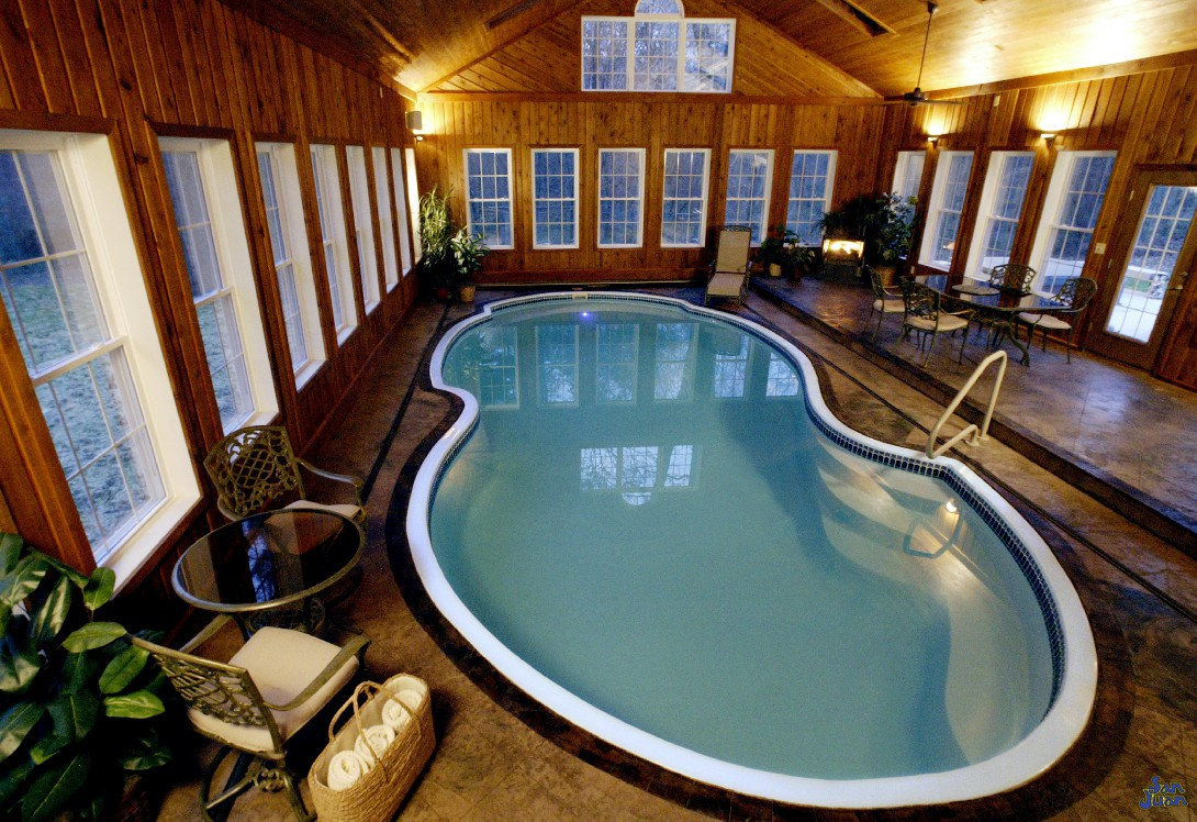 atlantic pool shape inside of indoor swimming pool cabin