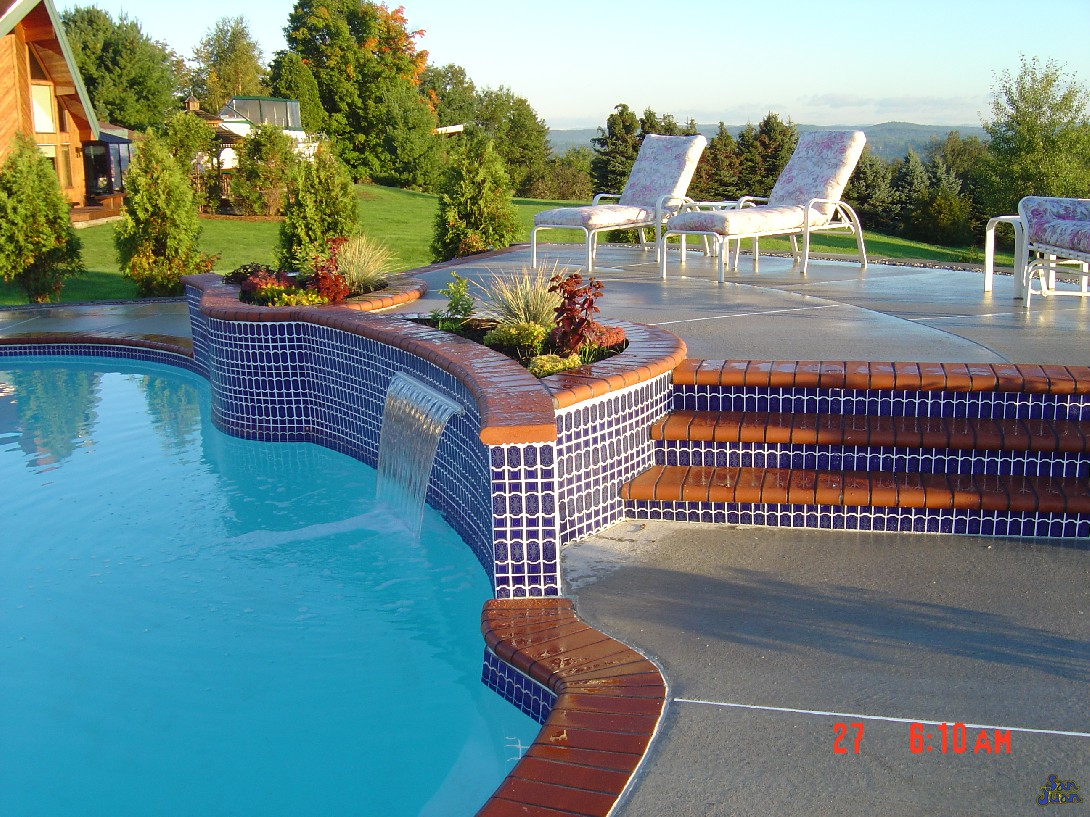 atlantic pool shape with raised decking and tile line