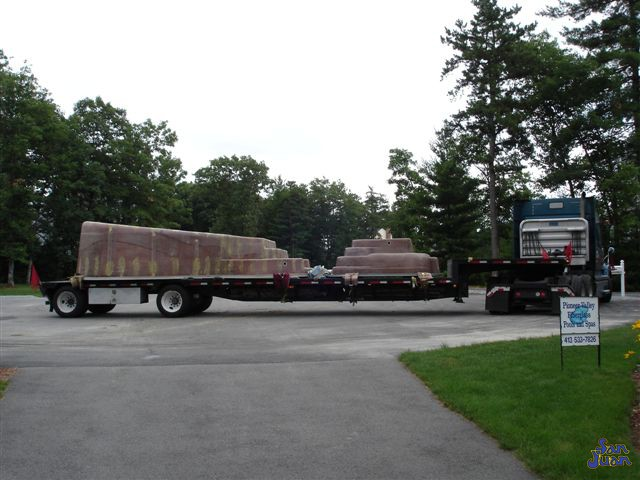 bayside fiberglass pool being delivered to the job site