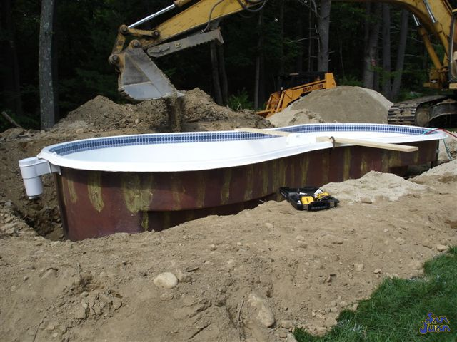 bayside fiberglass pool being installed and leveled