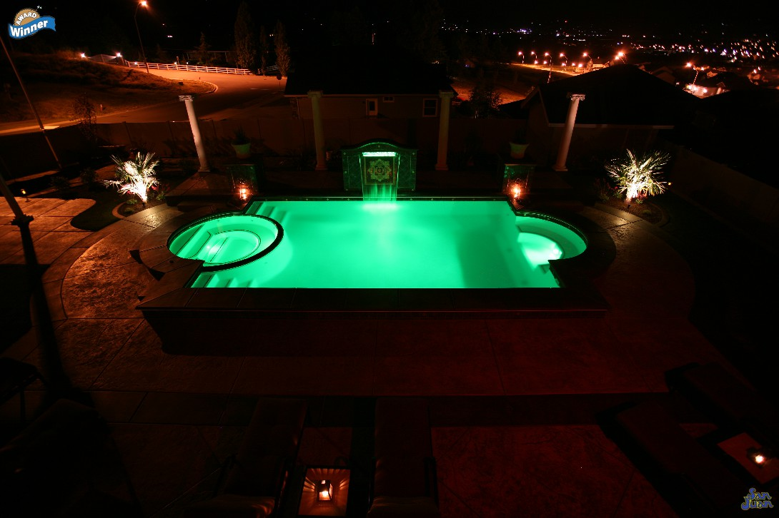 ceasars palace fiberglass pool shape at night with led lighting