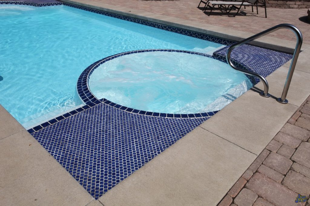 ceasars palace fiberglass pool shape with attached spa steps and handrail
