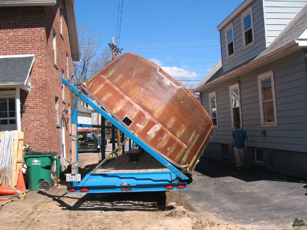 fiberglass pool being off loaded from a truck