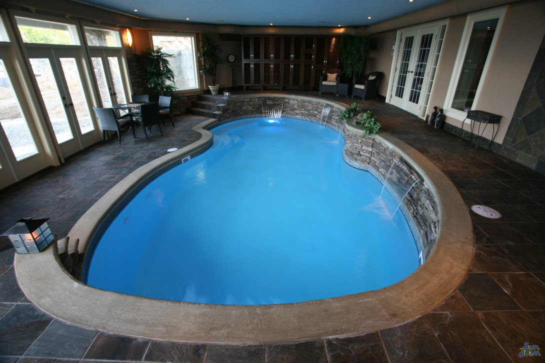fiberglass pool installed inside home with waterfalls (2)