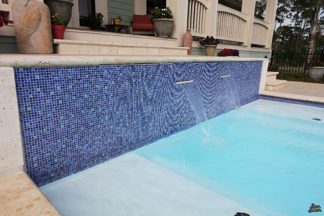 luxor deep fiberglass pool with raised tile wall and two waterfalls