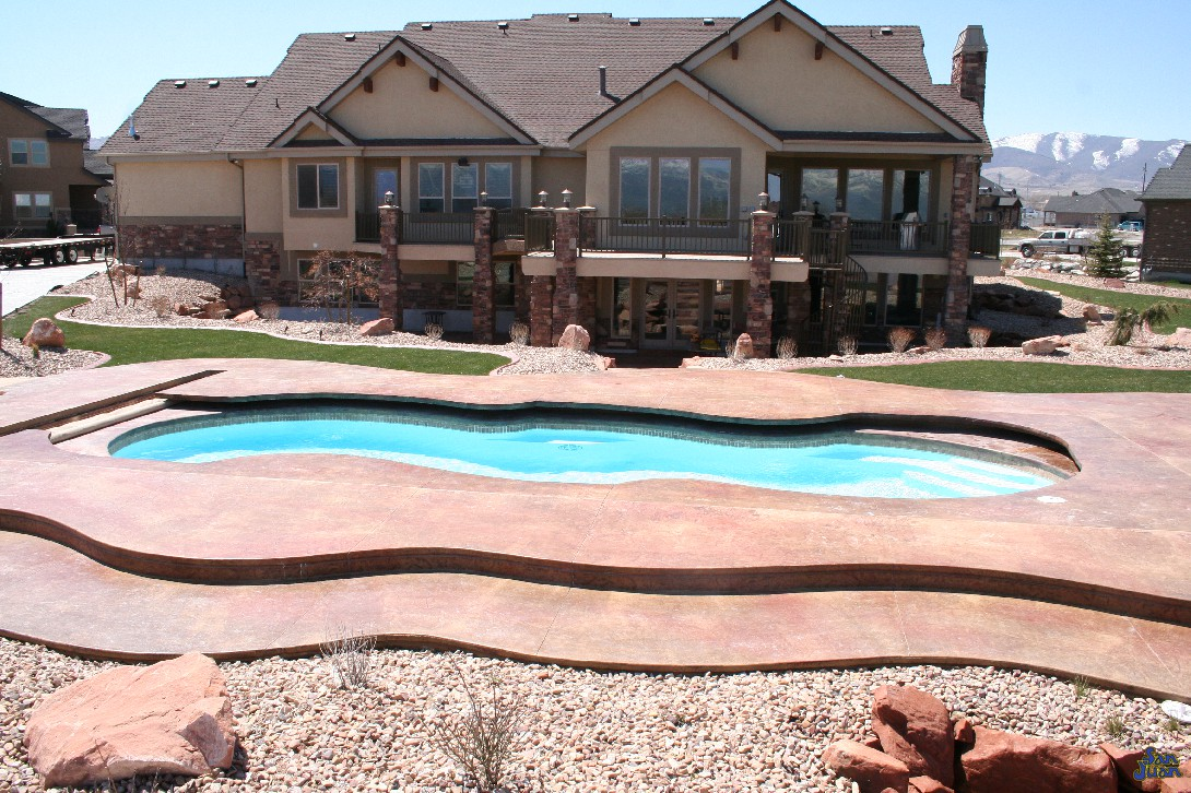 mirage pool shape at apartment complex with raised stamped concrete