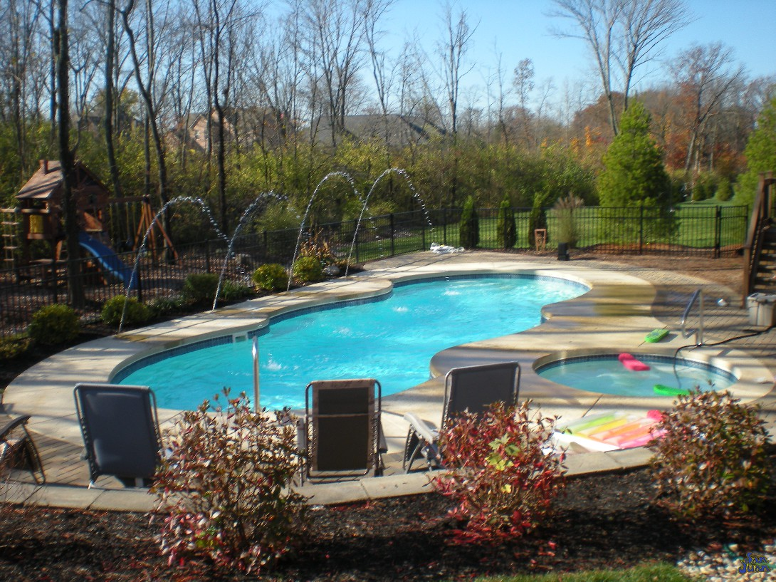 mirage pool shape in woods with spa and deck jets