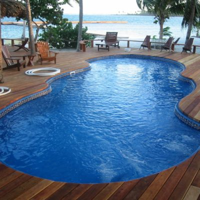 mirage pool shape with wooden deck in caribbean island