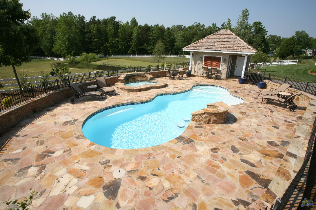 pleasure island fiberglass pool shape with natural travertine decking and outdoor kitchen (2)