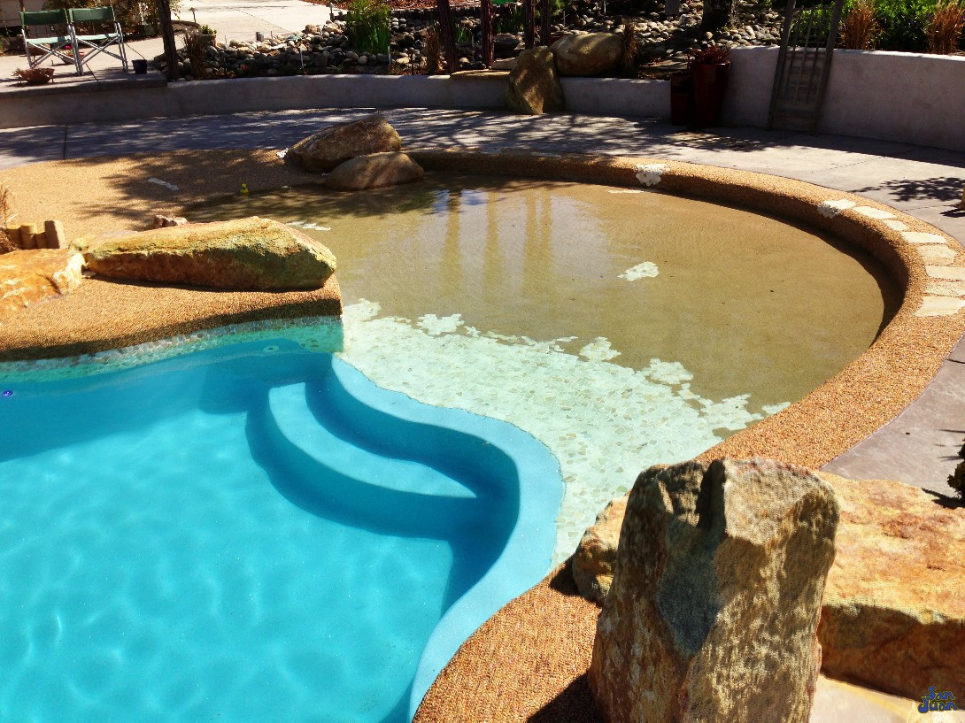 taj mahal fiberglass pool with beach entry and raised deck