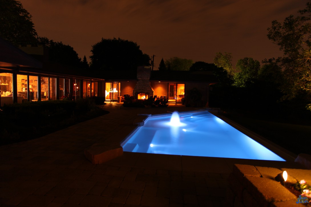 Harnessing the power of LED technology, we are able to create some amazing and unique images of our swimming pools. The iPool is a gorgeous combination of sharp-cut corners, water features and and design. This image shows how elegantly this swimming pool sits in your backyard - adding to its overall beautiful and utilization!