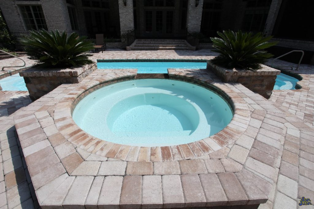 For all of our fiberglass pools, we have lots of added features that you can add on! In this example, this Phoenix Swimming Pool has an attached raised Spa to allow it's swimmers to heat up on a cool winter night. It's also another great place to gather for a relaxing evening with your favorite cocktail!