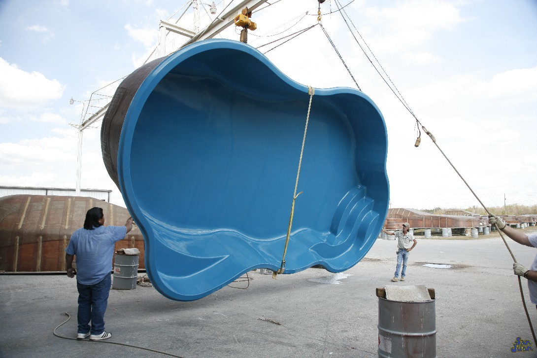 Our fiberglass shells are ready to ship from our factory! These pools are created from molds that routinely inspected and approved prior to each reuse. The manufacturing process only takes 1-2 days to complete and once the pool is thoroughly inspected, we are ready to ship it. This image shows our Rio pool being lifted and raised onto a semi-truck bound to another excited customer!