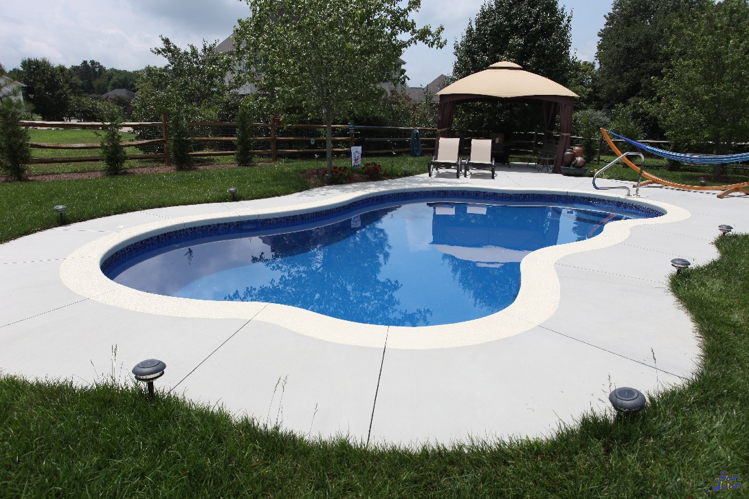 Here is one last look at our beautiful Rio fiberglass swimming pool. This pool fits perfectly in small backyards and pairs very well with add-on items to create a whole new look! Adding in some pool furniture and umbrella creates a perfect area to lay out and relax during the warm days of summer!