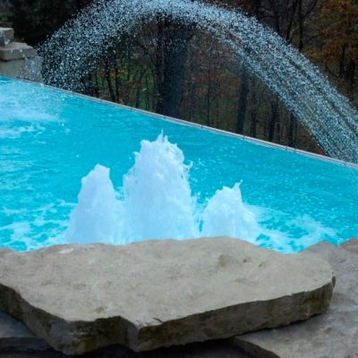 The iPool 2 is another modern-tech swimming pool. This swimming pool is designed to be paired with water features & advanced technology to create a fun & sophisticated look. We love this swimming pool because of all of the features that it offers. It easily outpaces your standard gunite swimming pool at a price that you will love!