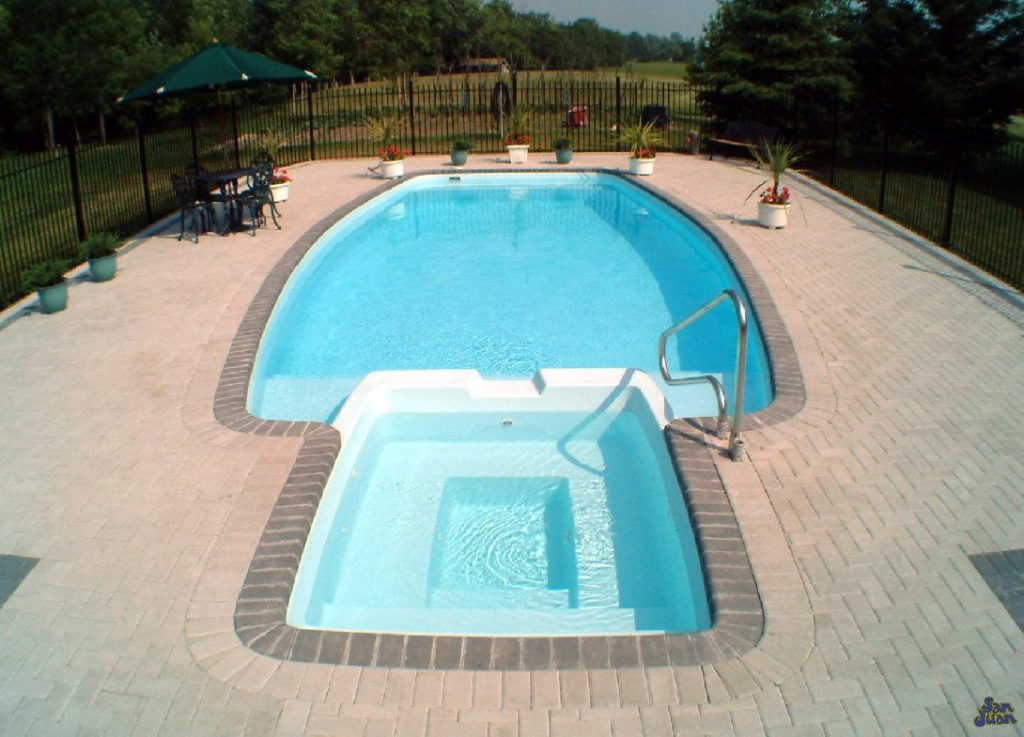 The Olympus is a unique fiberglass pool shape that sports a very nifty attached spa! This fiberglass pool is perfect for a family or multiple people that want to enjoy the full functionality of their fiberglass pool.