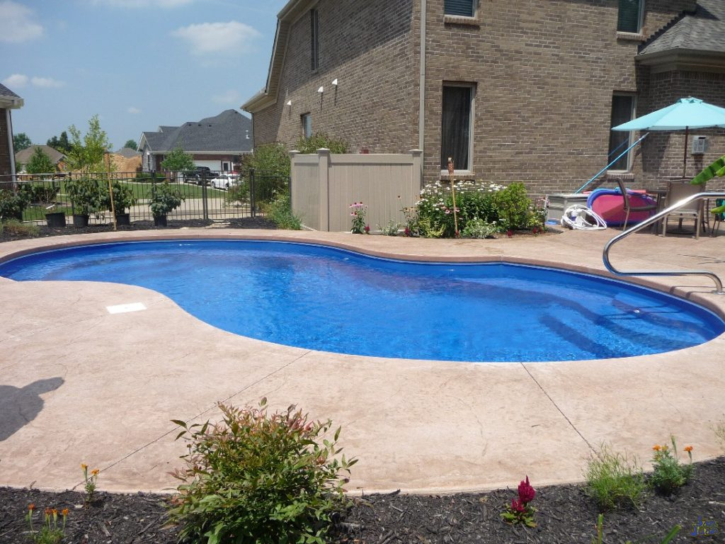 "The Venetian fiberglass pool has an overall length of 28' and a width of 14' 10"". This gives us a maximum surface area of 311 SQFT. With a body of water that small, our gallon size is only 9,500 Gallons. This is a small pool capable of delivering exceptional energy savings. Not only are you saving on backyard space, but your wallet will thank you for a lower electric bill than a larger swimming pool."