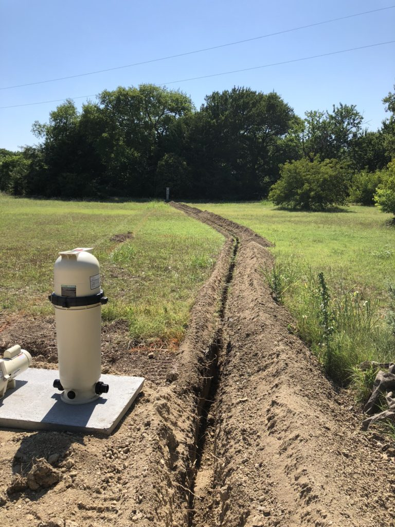 We are capable of working in all shapes and sizes of backyard spaces. This swimming pool in particular had a run of over 100 feet from our electrical supply to the swimming pool. In order to provide proper protection of our electrical components, we are trenching and running conduit from our pool shell to the electrical station.