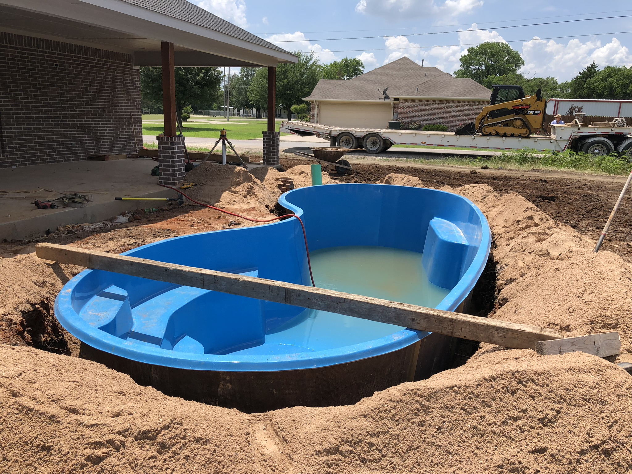 It ain't pretty right now but it will be once we're done! This image shows a beautiful Seaside Fiberglass Pool shell being installed in Tioga, TX. This home was recently built and the home owner hasn't even moved in yet. We are completing the installation of this beautiful pool and by the time the moving boxes arrive, they will be ready to take a cold plunge in their gorgeous fiberglass pool!