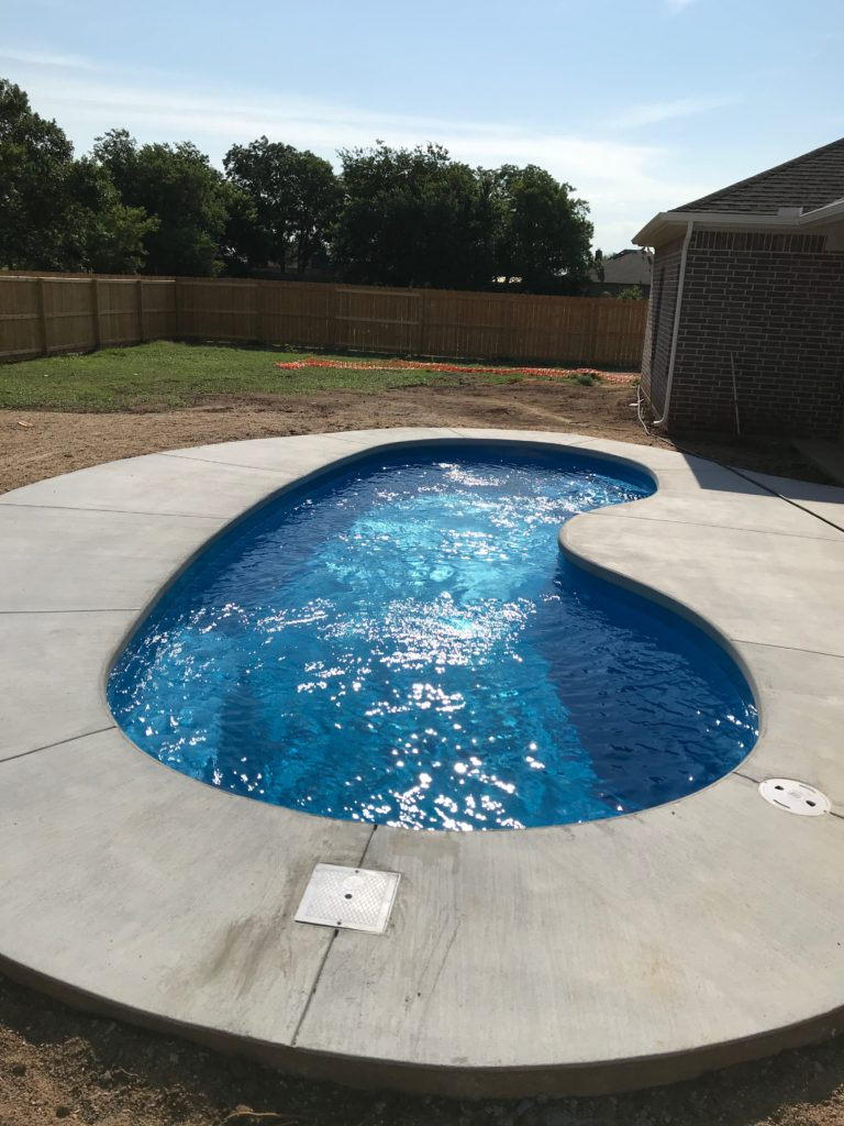 Another gorgeous fiberglass pool is installed by Fiberglass Pool Guyz! We installed this Seaside Pool Shell in record time. It only took us 7 days from the time that we broke ground to install our swimming pool and pour our concrete deck.