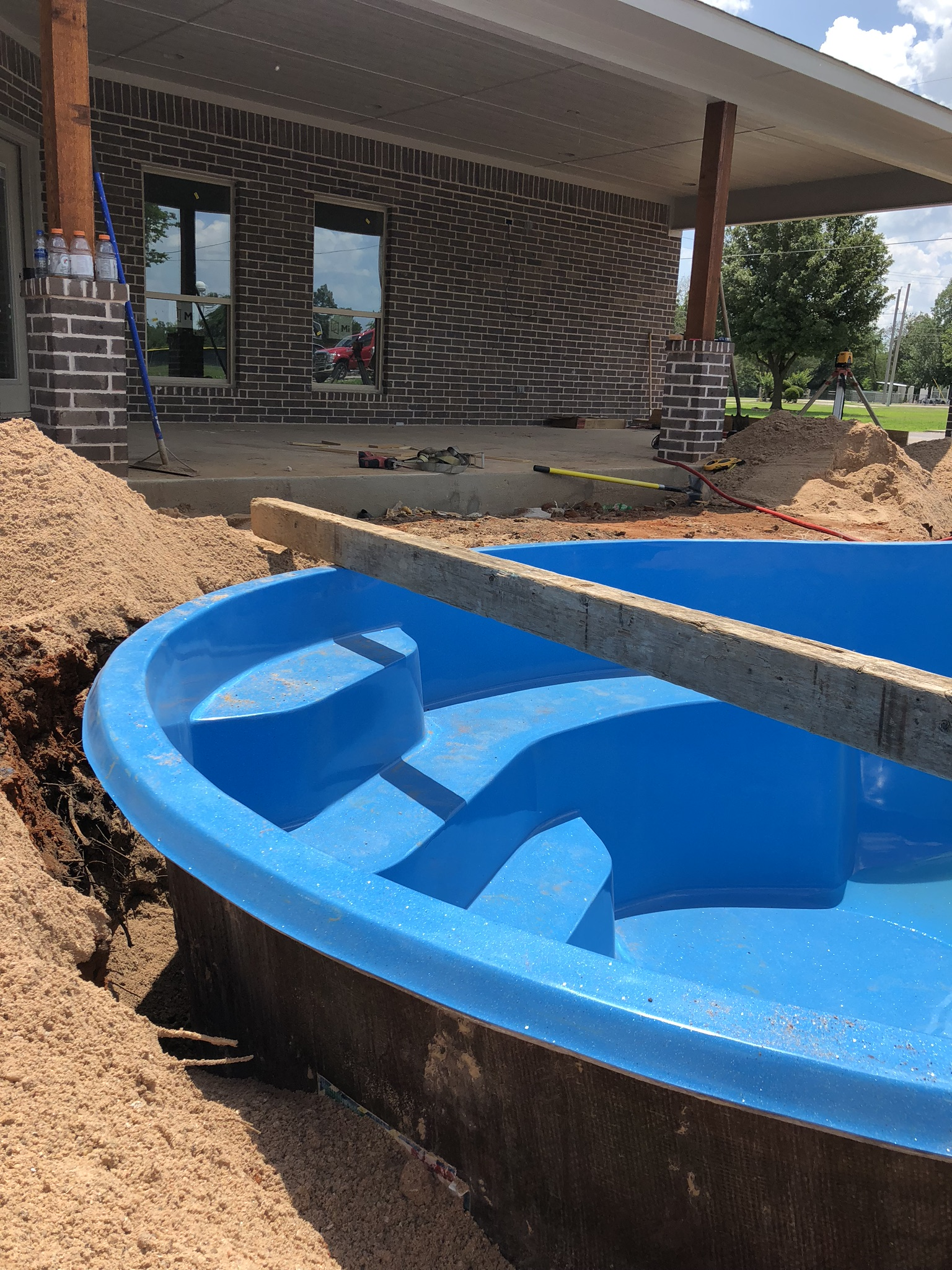 "As you can see from this image, we ""Over Dig"" our swimming pool by about 6""-12"". This allows our crews to properly set, ensure our pool is level and install our plumbing and electrical - once the pool is lowered into our hole."