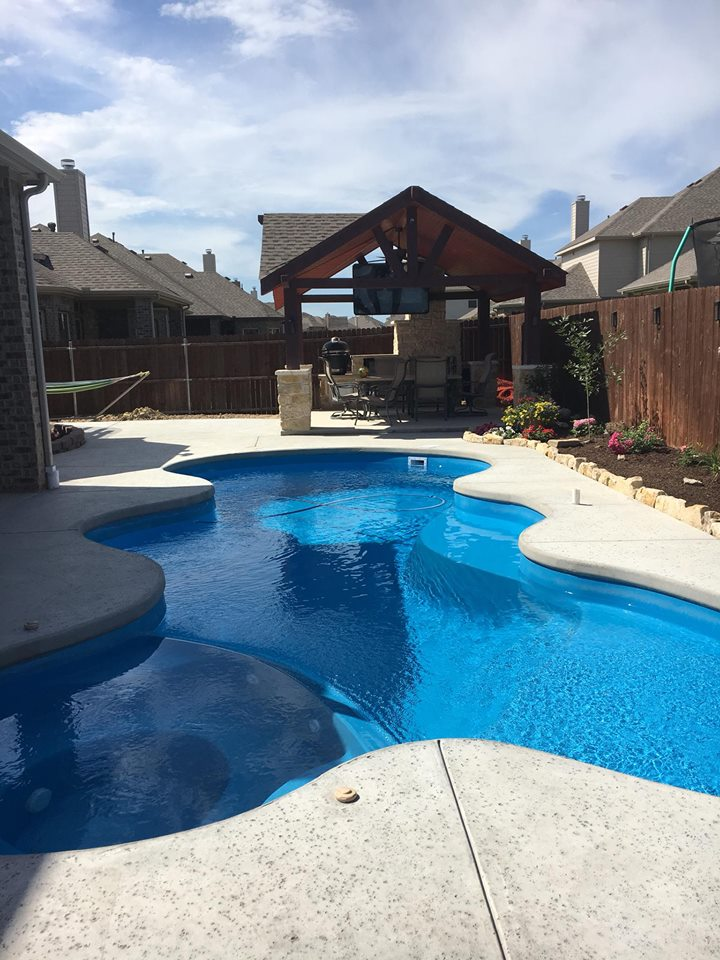 We loved working on this job. It presented some fun and interesting challenges due to it's compact yard, bedrock and multiple construction aspects. Throughout our entire project we installed the fiberglass swimming pool, concrete deck, raised waterfall and outdoor kitchen!