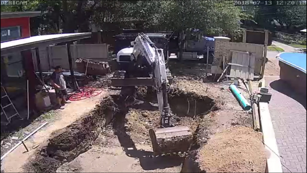 In order to set our swimming pool, we first have to remove some dirt. This image is taken as a snap shot of a time lapse - more to come on that later. Here you can see our excavator removing our natural soil to match the exact shape and dimensions of our swimming pool.