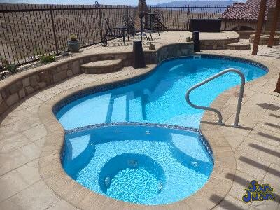 Here you see our Mandalay fiberglass pool shell paired with our light Sully Blue gel coat. It creates the perfect color that is both alluring and beautiful all year round!
