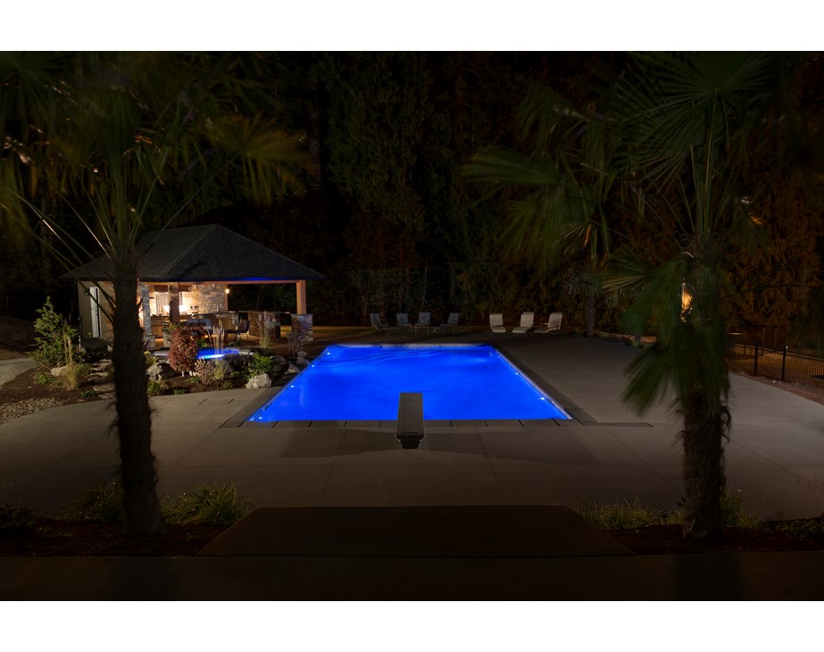 Here is a great example of how beautiful your fiberglass swimming pool will be with the Treo Light! Here you can see a fiberglass swimming pool with multiple Treo Lights. Able to be placed in nearly any location, these lights are exceptional for our line of fiberglass pools!
