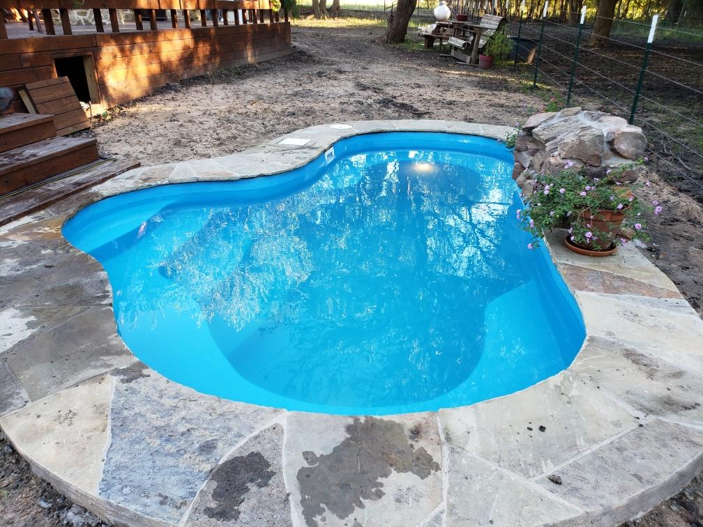 The Crystal Springs is a beautiful pool shape that is both petite & curvy. This free form pool shape sports a maximum depth of only 5' and provides plenty of bench seating for swimmers to rest and relax. With an overall volume of only 3,900 gallons, the Crystal Springs is easy to maintain! It's certainly a fun pool for any backyard!