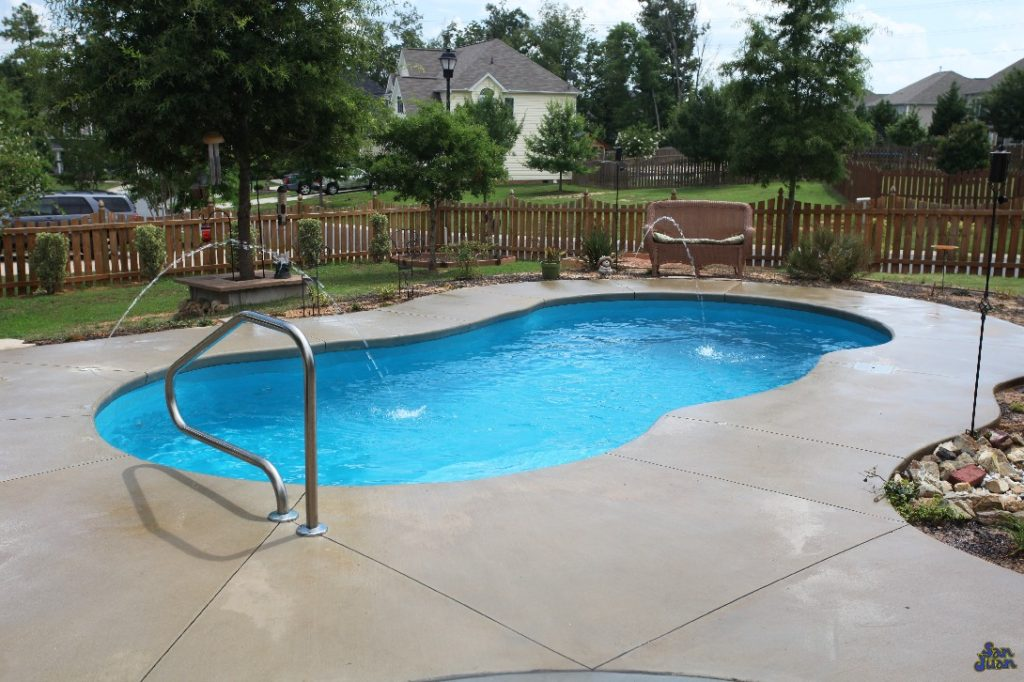 Here you can see the Lelani tucked away into a beautiful backyard landscape. This home owner has dressed up their Lelani with a complimentary pair of deck jets & figure-4 handrail. We recommend sprucing up your fiberglass swimming pool with these fun features. It's a great way to enhance your outdoor entertainment space!
