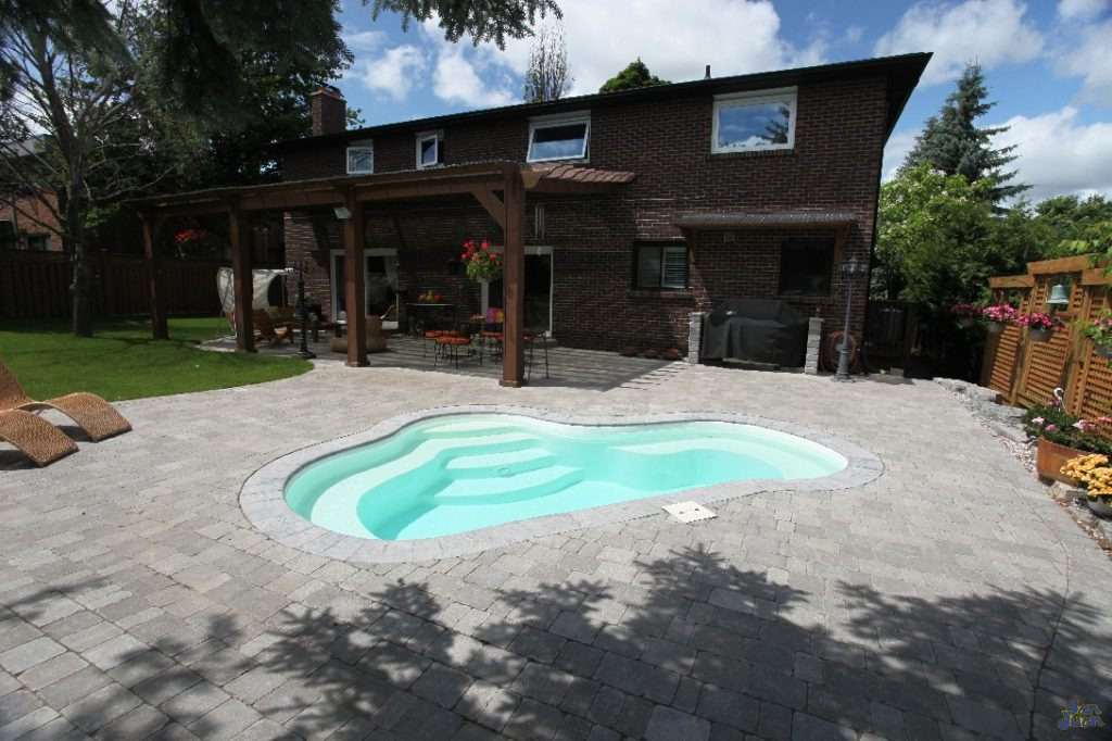 The Crystal Springs is a beautiful fiberglass pool & spa hybrid. Depending on your needs, the Crystal Springs can be used for cooling off or heating up. We love this pool & spa hybrid because of its large versatility for our clients needs.