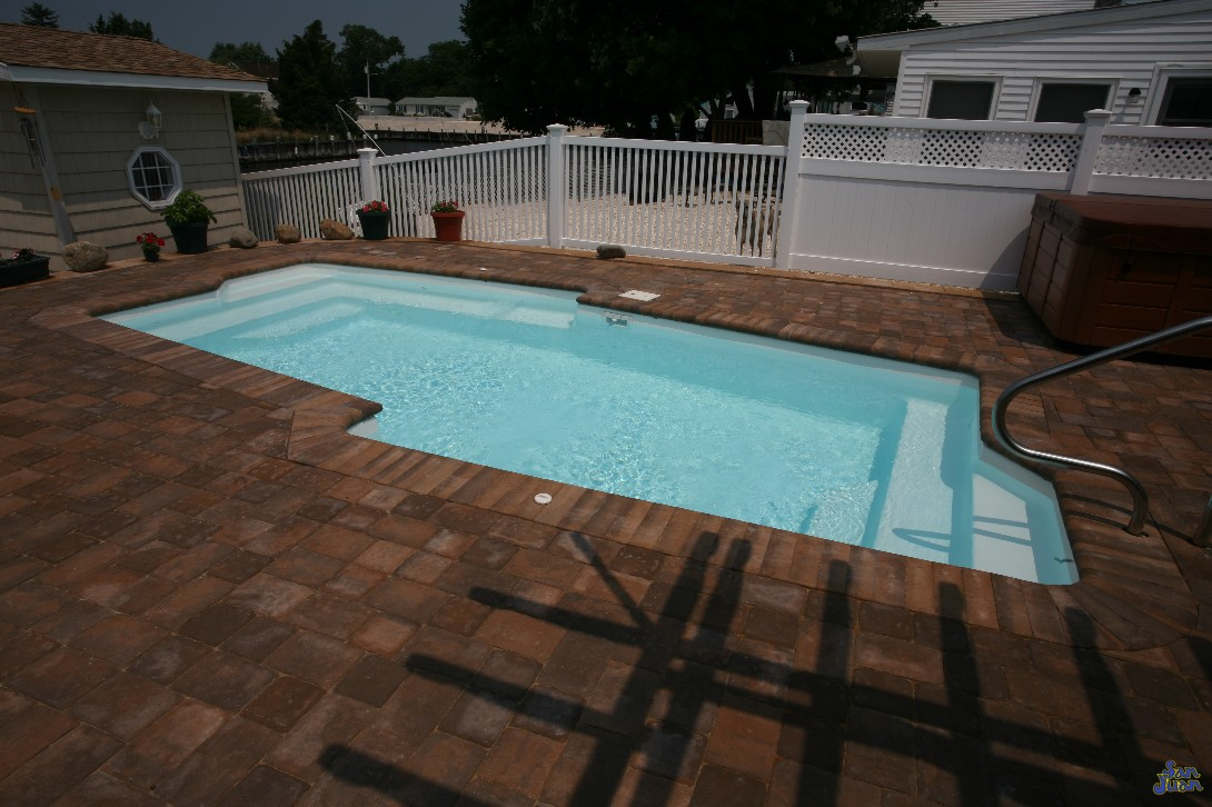 "The Malibu is a ""cutting edge"" free form fiberglass swimming pool with a flat bottom layout. This gorgeous pool shape includes a dual set of corner entry steps and a modern design to enhance your backyard experience!"