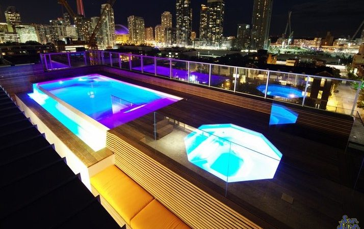 """The Grande Spa is deliciously """"grande"""" and can be installed in a wide array of settings! Here you can see it stationed atop a high rise facility with an outdoor living space right on the room - now that's a stunning view!"""
