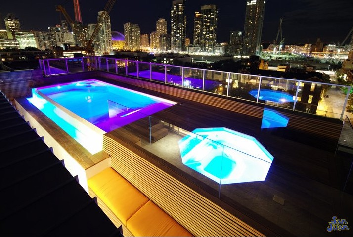 "The Grande Spa is deliciously ""grande"" and can be installed in a wide array of settings! Here you can see it stationed atop a high rise facility with an outdoor living space right on the room - now that's a stunning view!"