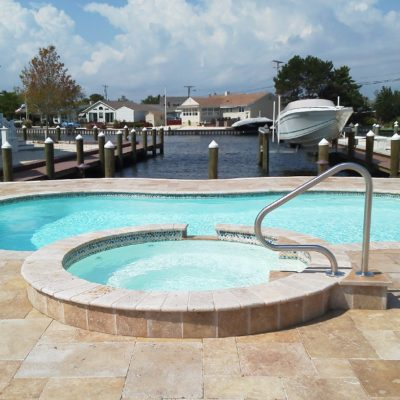 The Isle Spa is a classic and comfortable fiberglass spa that pairs perfectly with any of our fiberglass swimming pools. This ageless spa provides enough space for 6-8 bathers and has a wide wrap around bench for user comfort!