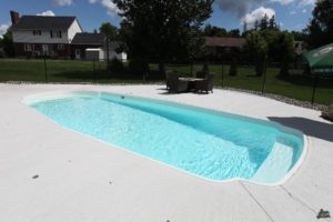 """The Savannah is a wide and luxurious fiberglass swimming pool. Built with a dual set of benches and spacious 32' 6"""" length - this pool provides plenty of room and seating for guests to enjoy long days in the Texas heat!"""