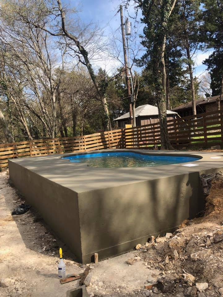 Our teams literally had to create a concrete box to hold this fiberglass pool in place. This was the safest and most cost effective route to install this beautiful pool for this very happy home owner!